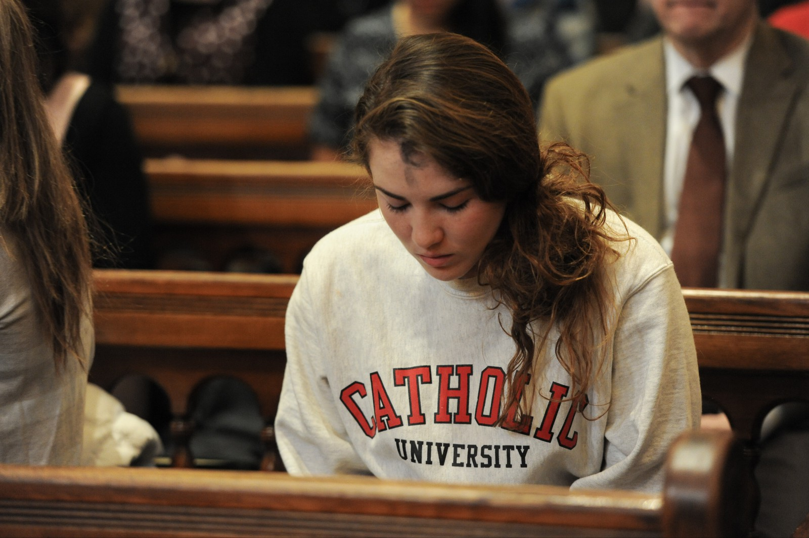 student praying on Ash Wednesday
