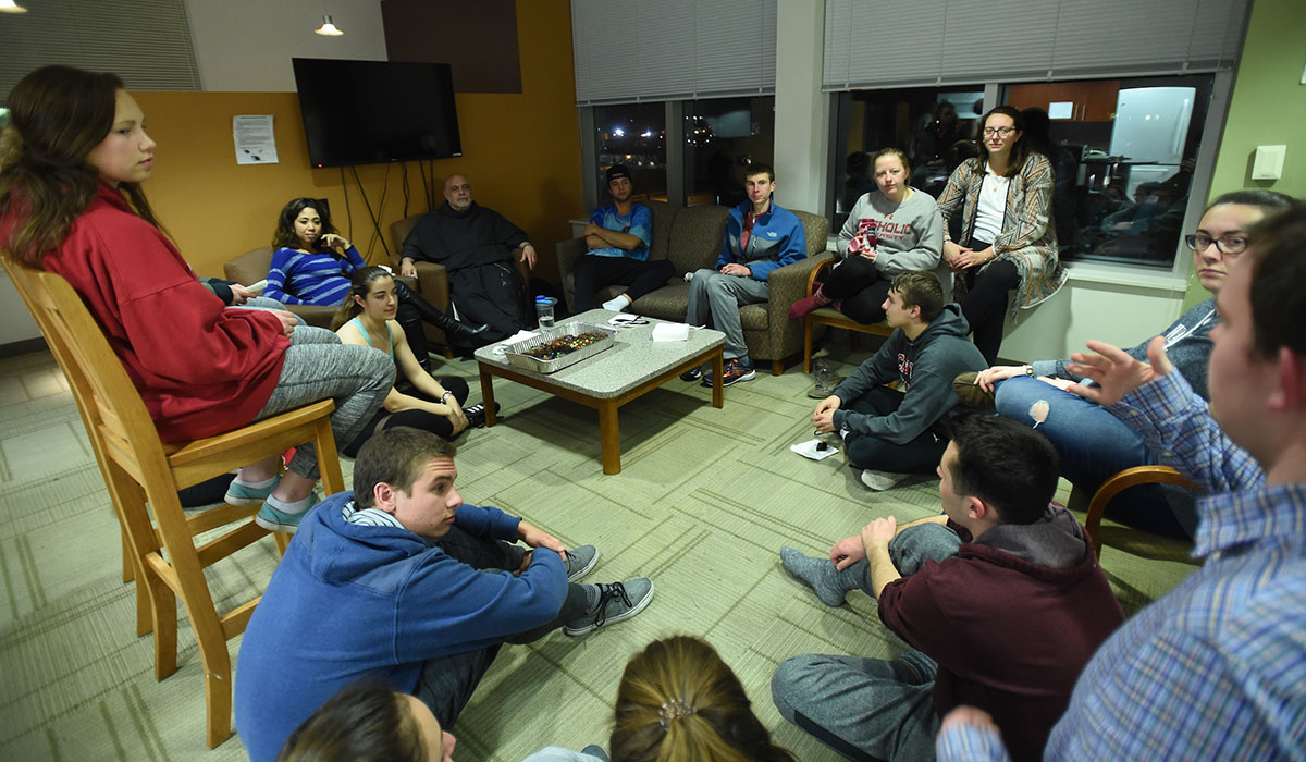 Students talking with pastoral staff in residence hall