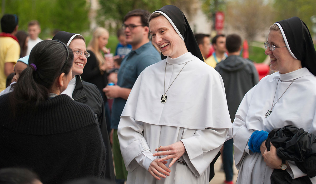 Nuns talking to student