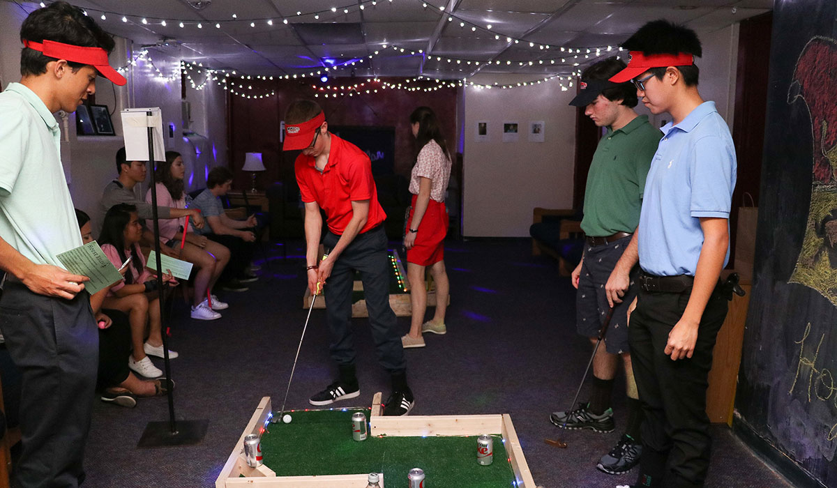 Students playing mini golf
